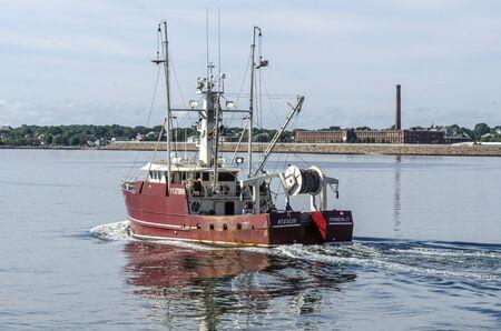 New Bedford, Massachusetts, USA - August 27, 2019: Commercial fishing boat Regulus, hailing port Stonington, Connecticut, leaving New Bedford