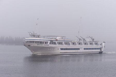 New Bedford, Massachusetts, USA - November 27, 2019: Cruise boat Grande Mariner leaving New Bedford inner harbor on foggy morning