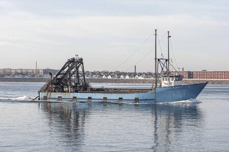 New Bedford, Massachusetts, USA - November 26, 2019: Commercial fishing boat E.S.S. Pursuit, hailing port Atlantic City, New Jersey, crossing New Bedford outer harbor 報道画像