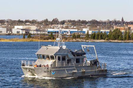 New Bedford, Massachusetts, USA - November 15, 2019: Research vessel Auk, an aluminum catamaran operated by Stellwagen Bank National Marine Sactuary, leaving New Bedford