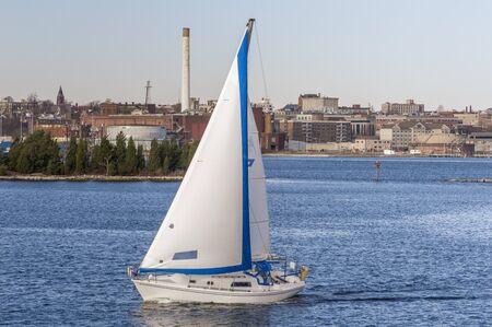 New Bedford, Massachusetts, USA - November 15, 2019: Sailboat Va Pensiero, hailing port Boston, Massachusetts,  crossing New Bedford inner harbor 報道画像