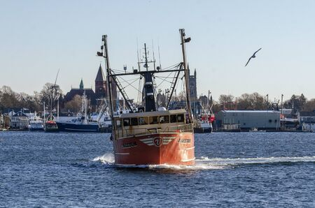 New Bedford, Massachusetts, USA - November 30, 2019: Commercial fishing boat Freedom making turn during sea trial in harbor