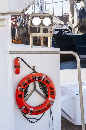 New Bedford, Massachusetts, USA - November 30, 2019: Pristine life ring positioned aboard new commercial fishing boat Aarsheim Junior