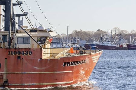 New Bedford, Massachusetts, USA - November 30, 2019: Commercial fishing boat Freedom sweeping past State Pier on sea trial