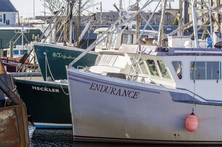 New Bedford, Massachusetts, USA - November 30, 2019: Dense cluster of commercial fishing boats on waterfront 報道画像