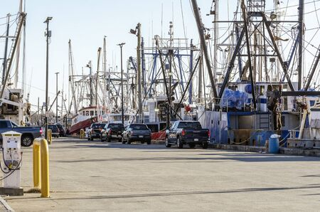 New Bedford, Massachusetts, USA - November 30, 2019: Commercial fishing boats lined up along Steamship Pier