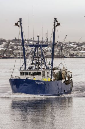 New Bedford, Massachusetts, USA - December 4, 2019: Commercial fishing boat United States on her way out of New Bedford