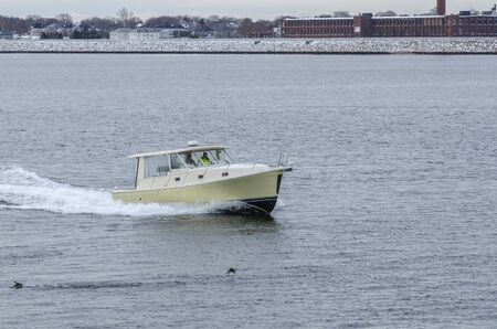 New Bedford, Massachusetts, USA - December 4, 2019: Powerboat ...And Beyond heading into New Bedford on late autumn morning 報道画像