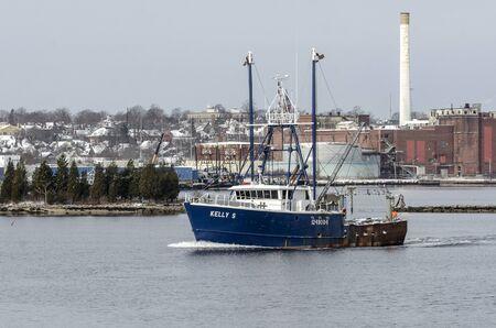 Fairhaven, Massachusetts, USA - December 4, 2019: Scalloper Kelly S crossing New Bedford inner harbor on her way to sea
