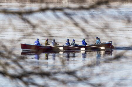 Fairhaven, Massachusetts, USA - December 8, 2019: Whaleboat team practicing on Acushnet River on chilly late autumn morning Redactioneel