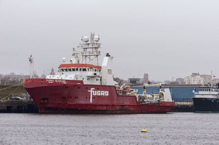 New Bedford, Massachusetts, USA - December 10, 2019: Offshore survey vessel Fugro Searcher docked at Marine Commerce Terminal