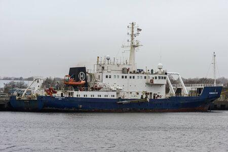 New Bedford, Massachusetts, USA - December 10, 2019: Offshore survey vessel Kommador Iona docked at Marine Commerce Terminal between work stints on Long Island Sound