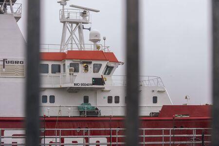 New Bedford, Massachusetts, USA - December 9, 2019: Offshore survey vessel Fugro Searcher transiting hurricane barrier after work stint on Long Island Sound Redakční