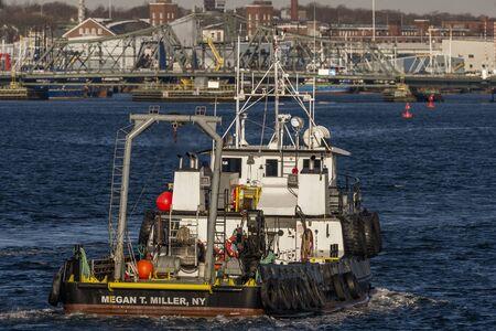 Fairhaven, Massachusetts, USA - December 7, 2019: Utility boat Megan T. Miller crossing New Bedford inner harbor toward Fairhaven Redakční