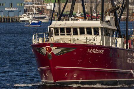 Fairhaven, Massachusetts, USA - December 7, 2019: Commercial fishing boat Vanquish crossing New Bedford inner harbor toward Fairhaven