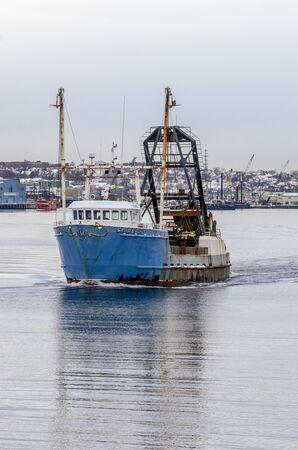 New Bedford, Massachusetts, USA - December 4, 2019: Clammer Starlight leaving New Bedford to go fishing Redakční