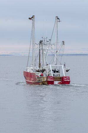 New Bedford, Massachusetts, USA - December 4, 2019: Commercial fishing boat Capt. Jesse, hailing port Cape May, New Jersey, leaving New Bedford to go fishing Redakční