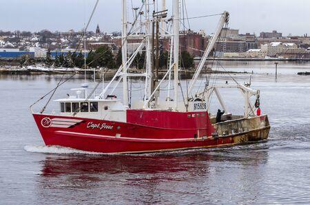 New Bedford, Massachusetts, USA - December 4, 2019: Commercial fishing boat Capt. Jesse, hailing port Cape May, New Jersey, leaving New Bedford inner harbor