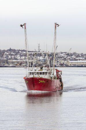 New Bedford, Massachusetts, USA - December 4, 2019: Trawler Fisherman crossing New Bedford inner harbor
