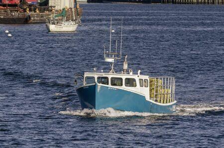 New Bedford, Massachusetts, USA - November 26, 2019: Commercial fishing boat Voyager going lobstering