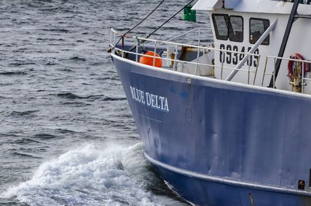 New Bedford, Massachusetts, USA - October 7, 2019: Commercial fishing boat Blue Delta leaving New Bedford