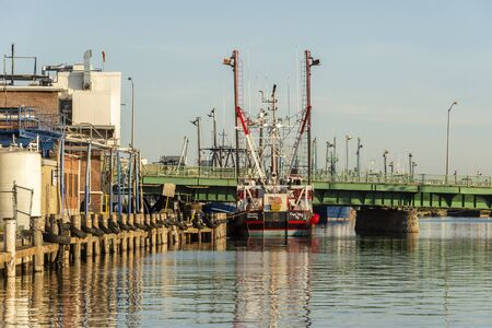 New Bedford, Massachusetts, USA – September 28, 2019: Commercial fishing vessel Atlantic Bounty, hailing port Cape May, New Jersey, docked at ice plant in New Bedford