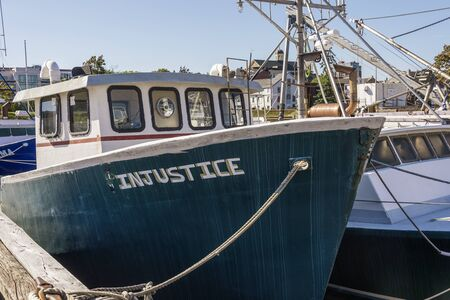 New Bedford, Massachusetts, USA – September 28, 2019: Bow of fishing boat Injustice docked in New Bedford