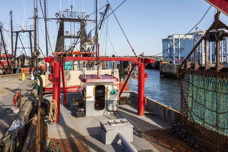 New Bedford, Massachusetts, USA – September 28, 2019: Deck of scalloper with raised dredge docked at Pier 3 in New Bedford Redakční