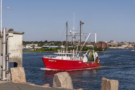 New Bedford, Massachusetts, USA - August 20, 2019: Trawler Mary K transiting hurricane barrier on her way fishing