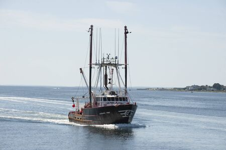 New Bedford, Massachusetts, USA - August 20, 2019: Commercial fishing vessel Barbara Anne, hailing port Cape May, New Jersey, crossing New Bedford outer harbor