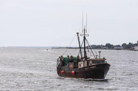 New Bedford, Massachusetts, USA - September 2, 2019: Commercial fishing boat Kelly Marie crossing New Bedford outer harbor Redakční