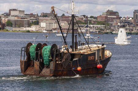 New Bedford, Massachusetts, USA - September 2, 2019: Trawler Kelly Marie crossing New Bedford inner harbor