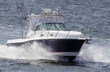 New Bedford, Massachusetts, USA - September 2, 2019: Recreational fishing boat crossing New Bedford outer harbor