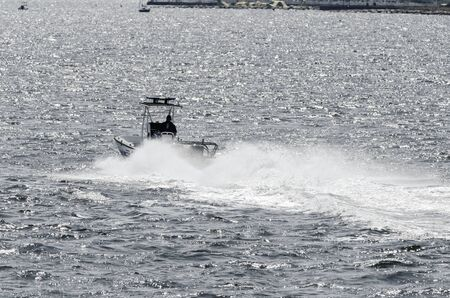 New Bedford Police Department patrol boat zipping across outer harbor on bright summer afternoon