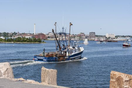 Fairhaven, Massachusetts, USA - August 20, 2019: Commercial fishing boat Tom Slaughter II, hailing port Gloucester, Massachusetts, clearing hurricane barrier Redakční