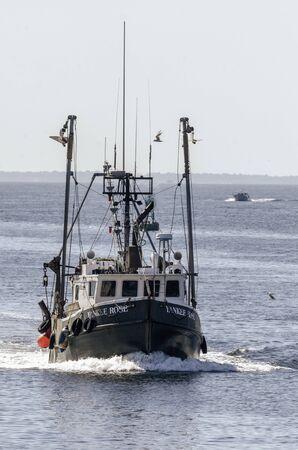 New Bedford, Massachusetts, USA - August 20, 2019: Trawler Yankee Rose coming out of Buzzards Bay Redakční