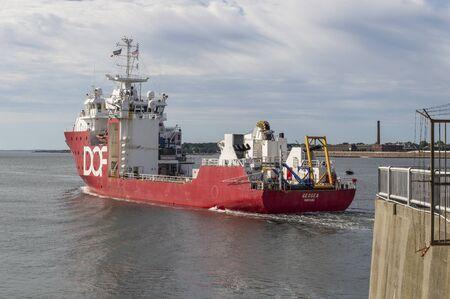 New Bedford, Massachusetts, USA - September 8, 2019: Survey vessel DOF Geosea heading toward Buzzards Bay after transiting hurricane barrier Redakční