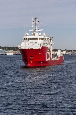 New Bedford, Massachusetts, USA - September 8, 2019: Survey vessel DOF Geosea heading across New Bedford inner harbor en route to duty in Long Island Sound Éditoriale
