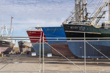 Fairhaven, Massachusetts, USA - September 8, 2019: Thicket of commercial fishing boats hauled out for maintenance at Fairhaven Shipyard Redakční