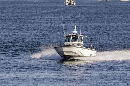 Fairhaven, Massachusetts, USA - August 5, 2019: Fairhaven Harbormaster patrol boat hustling out of harbor Redakční