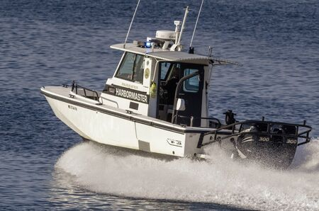 Fairhaven, Massachusetts, USA - August 5, 2019: Fairhaven Harbormaster patrol boat crossing New Bedford outer harbor
