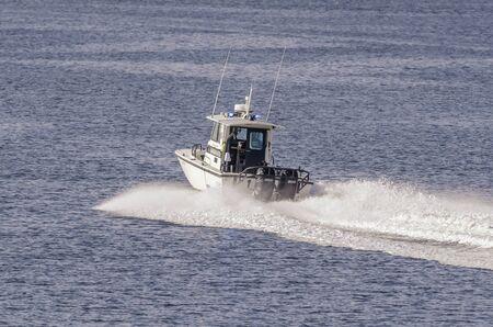 Fairhaven, Massachusetts, USA - August 5, 2019: Fairhaven Harbormaster patrol boat hustling towards Buzzards Bay