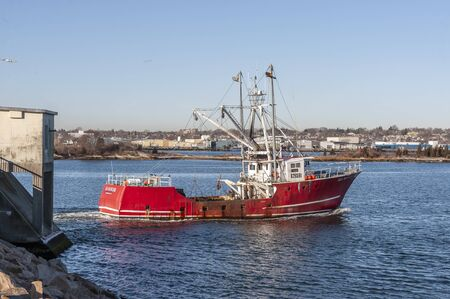 New Bedford, Massachusetts, USA - January 22, 2020: Commercial fishing boat Sea Ranger transiting hurricane barrier on winter morning Editorial