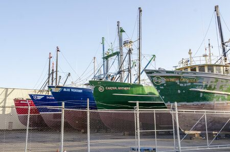 Fairhaven, Massachusetts, USA - February 23, 2020:  Lineup of hauled out commercial fishing boats in shipyard