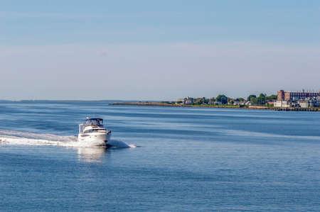 New Bedford, Massachusetts, USA - June 9, 2019: Motor yacht On My Own V cruising toward New Bedford