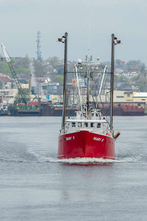 New Bedford, Massachusetts, USA - May 7, 2018: Commercial fishing vessel Mary K, hailing port Woods Hole, Massachusetts, leaving New Bedford Redakční