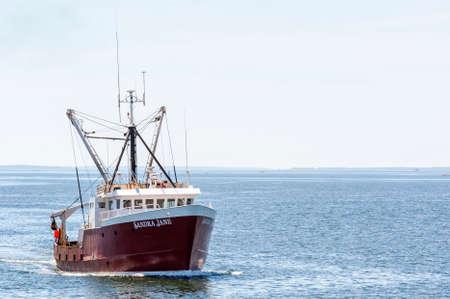 Fairhaven, Massachusetts, USA - May 21, 2018: Scalloper Sandra Jane coming out of Buuzards Bay