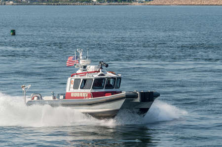 New Bedford, Massachusetts, USA - May 25, 2018: New Bedford Fire Rescue patrol boat heading back to port from Buzzards Bay