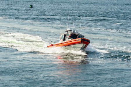 Fairhaven, Massachusetts, USA - May 25, 2018: Fairhaven Fire Department patrol boat busts through wake while heading back to port from Buzzards Bay