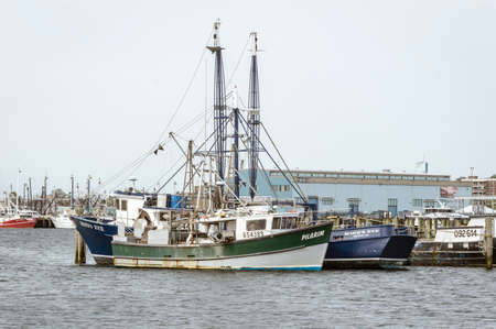 New Bedford, Massachusetts, USA - May 18, 2018: Commercial fishing vessels Pilgrim and Mind's Eye moored at Pope's Island in New Bedford